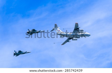 MOSCOW/RUSSIA - MAY 9: Il-78 (Midas) aerial tanker demonstrates refueling of 2 MiG-31 (Foxhound) supersonic interceptors on parade devoted to 70-th Victory Day aniversary on May 9, 2015 in Moscow. - stock photo