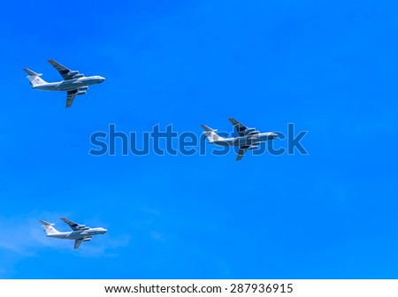 MOSCOW/RUSSIA - MAY 7: 3 Ilyushin Il-76 (Candid) multi-purpose four-engined strategic airlifters fly on rehearsal of parade devoted to 70-th Victory Day aniversary on May 7, 2015 in Moscow.