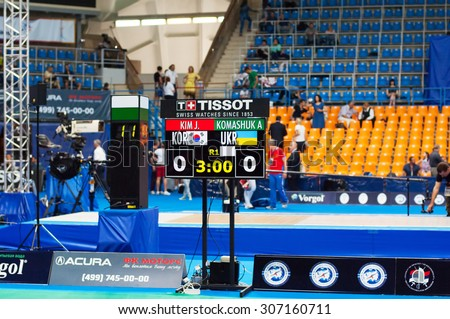 MOSCOW, RUSSIA - MAY 31 2015: J. Kim and A. Komashuk score board on the World  fencing Grand Prix Moscow Saber in Luzhniki sport palace - stock photo