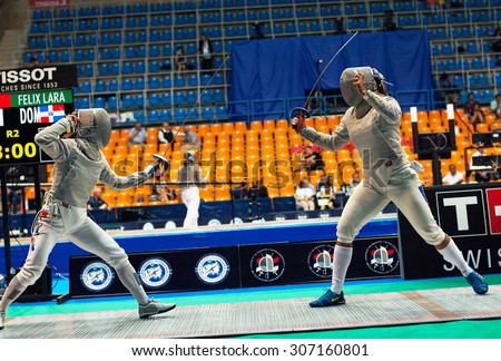 MOSCOW, RUSSIA - MAY 31 2015: J. Kim and L. Felix fights on the World  fencing Grand Prix Moscow Saber in Luzhniki sport palace