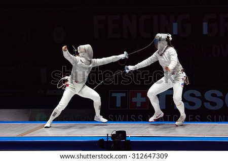 MOSCOW, RUSSIA - MAY 31 2015: J. Kim (L) versus S. Velikaya (R) on the World  fencing Grand Prix Moscow Saber in Luzhniki sport palace - stock photo