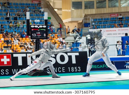 MOSCOW, RUSSIA - MAY 31 2015: Jung Kim and Alina Komashuk fights on the World  fencing Grand Prix Moscow Saber in Luzhniki sport palace - stock photo