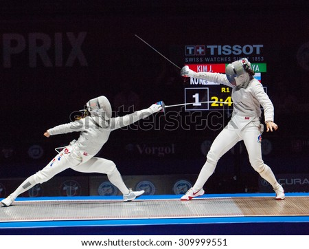 MOSCOW, RUSSIA - MAY 31 2015: Jung Kim attack Sofia Velikaya on the World  fencing Grand Prix Moscow Saber in Luzhniki sport palace - stock photo
