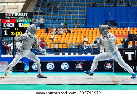 MOSCOW, RUSSIA - MAY 31 2015: Jung Kim versus Alina Komashuk on the World  fencing Grand Prix Moscow Saber in Luzhniki sport palace - stock photo