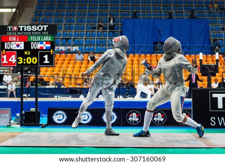 MOSCOW, RUSSIA - MAY 31 2015: Jung Kim versus Lara Felix on the World  fencing Grand Prix Moscow Saber in Luzhniki sport palace - stock photo