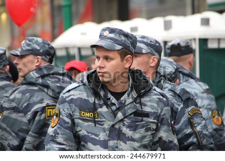Moscow, Russia - May 9, 2012. March of communists on the Victory Day. Staff of the Russian police protects political procession