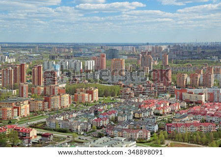 MOSCOW, RUSSIA - MAY 05, 2015: Moscow cityscape. Top view of the Kurkino District of Moscow, North-Western Administrative Okrug situated beyond the Moscow ring road - stock photo
