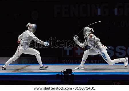 MOSCOW, RUSSIA - MAY 31 2015: O. Kharlan (L) versus V. Vougiouka (R) just before finals on the World  fencing Grand Prix Moscow Saber in Luzhniki sport palace - stock photo