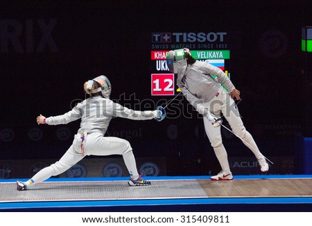 MOSCOW, RUSSIA - MAY 31 2015: O. Kharlan (L) vs S. Velikaya (R) on final during the World  fencing Grand Prix Moscow Saber in Luzhniki sport palace - stock photo
