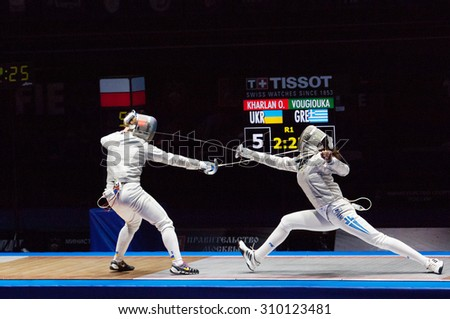 MOSCOW, RUSSIA - MAY 31 2015: O. Kharlan (L) vs V. Vougiouka (R) just before finals on the World  fencing Grand Prix Moscow Saber in Luzhniki sport palace - stock photo