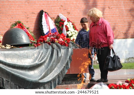 Moscow, Russia - May 9, 2012. People lay flowers at the Eternal flame in Aleksandrovsk to a garden in the Victory Day
