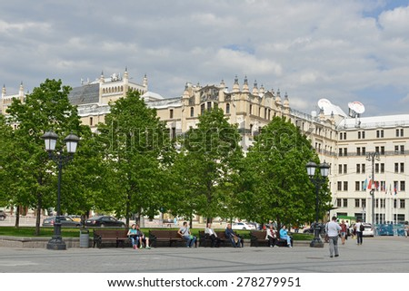 MOSCOW, RUSSIA - MAY 13, 2014:People resting in park in Revolution Square. Revolution Square is square located in center of Moscow, in Tverskoy District, northwest of Red Square - stock photo