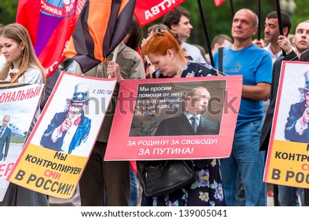 MOSCOW, RUSSIA - 18 MAY 2013: Pro-Putin meeting 'Mass Media - Stop Lying!' in Moscow, Russia. Placard with Uncle Sam reads 'We control mass media in Russia from 1991' Moscow 18 May 2013