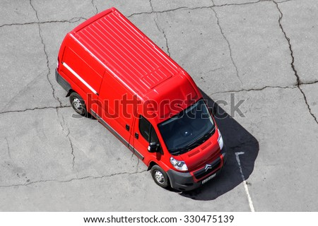 MOSCOW, RUSSIA - MAY 9, 2013: Red cargo van Peugeot Boxer at the city street. - stock photo