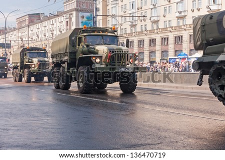 MOSCOW/RUSSIA - MAY 9: Russian Army Ural-4320 off-road 6x6 armoured truck motorcade moves on display during parade festivities devoted to 65th anniversary of Victory Day on May 9, 2010 in Moscow.