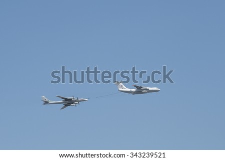 MOSCOW, RUSSIA - MAY, 09 2015: Russian fighters fly over Red Square during Victory Day parade. Filling in the air. Russia. Celebration of the 70th anniversary of the Victory Day - stock photo