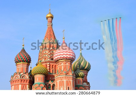 Moscow, Russia, May, 09,2015, Russian scene: Flying aircrafts over Red square near The Cathedral of Vasily Blazhenny