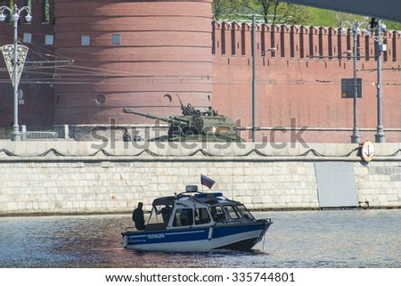 MOSCOW, RUSSIA - MAY, 09 2015: Russian tanks runs through Kremlyovskaya embankment over Moscow during Victory Day parade, Russia. Celebration of the 70th anniversary of the Victory Day - stock photo