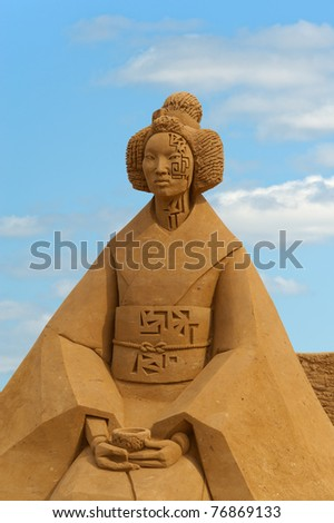 """MOSCOW, RUSSIA- MAY 11: Sculpture the """"Zen-softuer"""" by Irina Tavleskaja at Moscow festival of sandy sculptures in Kolomenskoye May 11, 2009 in Moscow, Russia.. - stock photo"""