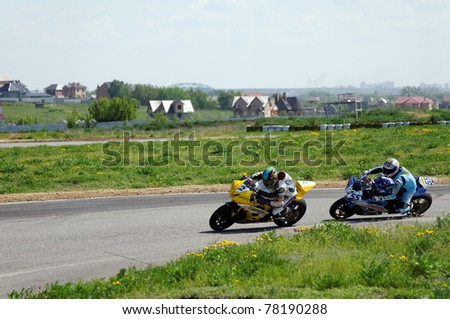MOSCOW, RUSSIA- MAY 22: Sergey Orlov (No. 2, left ) overtakes Sergey Krapukhin (No. 55, right) during the Supersport Racing Championship on May 22, 2011 in Moscow, Russia