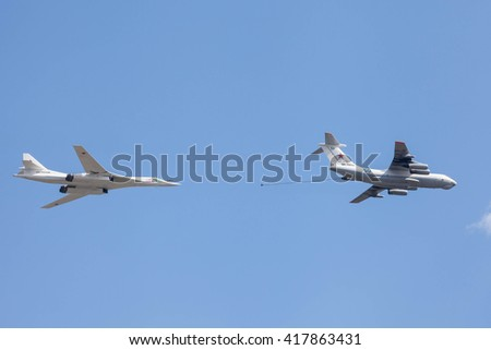 MOSCOW, RUSSIA - MAY 9, 2016: Soviet air tanker Ilyushin IL-78 and Soviet strategic bomber Tupolev Tu-160 simulate in-flight refueling at Parade of Victory in World War II May 9, 2016 in Moscow