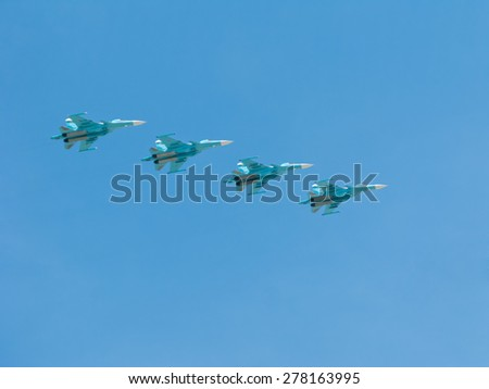 MOSCOW/RUSSIA - MAY 7: 4 Sukhoi Su-34 (Fullback) twin-seat fighter-bomber aircrafts on rehearsal of parade devoted to 70-th Victory Day aniversary on May 7, 2015 in Moscow.  - stock photo