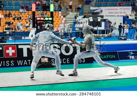MOSCOW, RUSSIA - MAY 31 2015: Svetlana Kormilitsyna (RUS) and Sara Balzer (FRA) fights on the World  fencing Moscow Sabre Grand Prix in Luzhniki sport palace - stock photo