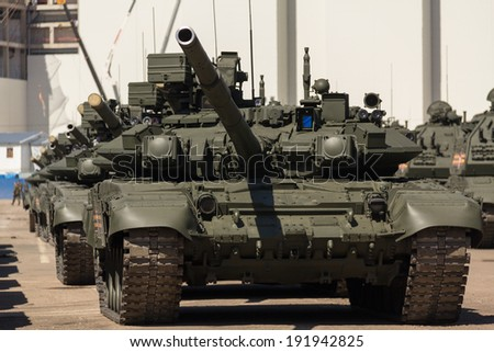 MOSCOW/RUSSIA - MAY 5: T-90A main battle tanks move in motorcade on Tverskaya Zastava square during night rehearsal of parade devoted to Victory Day on May 5, 2014 in Moscow. - stock photo