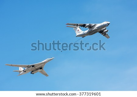 "Moscow, Russia - May 7, 2015: tanker Il-78 and strategic bomber and missile platform Tu-160 ""White swan"" in the sky Russian fighters, from training to the parade on May 9th."