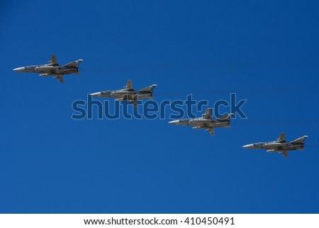 Moscow, Russia - May 9, 2014: The group of Soviet strategic bomber Tupolev Su-24 (NATO reporting name: Fencer) in flight at Parade of Victory in World War II May 9, 2014 in Moscow