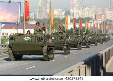 MOSCOW, RUSSIA - MAY 09, 2016:The movement of the column Russian armored personnel carrier BTR-MD Rakushka on parade festivities devoted to 71 anniversary of Victory Day on May 9, 2016 in Moscow. - stock photo