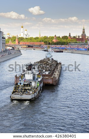 MOSCOW, RUSSIA - MAY 07, 2016: Transportation of scrap metal on a barge on Moskwa River. - stock photo