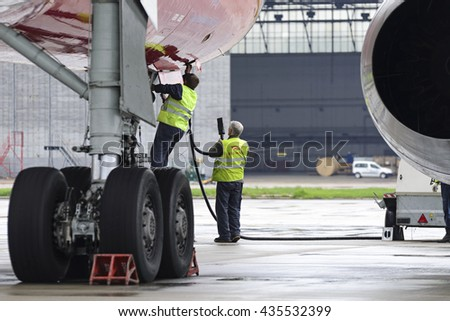MOSCOW, RUSSIA - MAY 19, 2016:Tu204 Red Wings airline. Service engineers carried out work on the preparation of the aircraft for the flight. - stock photo