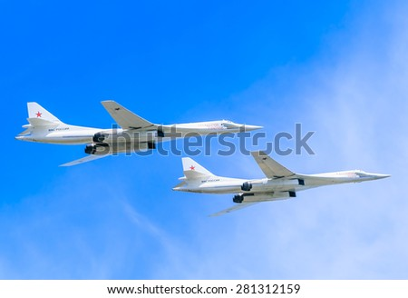 MOSCOW/RUSSIA - MAY 9: 2 Tupolev Tu-22M3 (Backfire) supersonic swing-wing long-range strategic and maritime strike bombers fly on parade devoted to Victory Day aniversary on May 9, 2015 in Moscow.