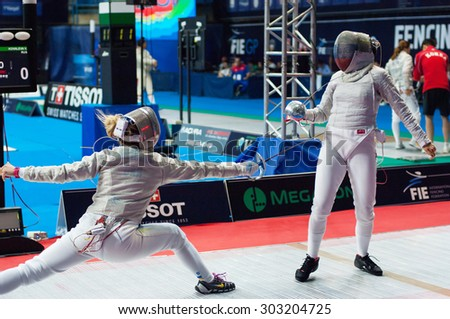 MOSCOW, RUSSIA - MAY 31 2015: V. Kovaleva and O. Kharlan fencing on the World  fencing Grand Prix Moscow Saber in Luzhniki sport palace - stock photo