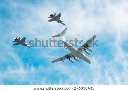 MOSCOW, RUSSIA - MAY 9, 2015. Victory Parade in Red Square to commemorate 70th anniversary of victory in the Great Patriotic war. IL-78 refueling tanker demonstrates in-flight refueling of  MiG-31. - stock photo