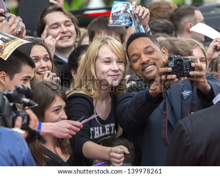 MOSCOW, RUSSIA - MAY 27: Will Smith takes photo with a fan during a photo-call for the film After Earth on May 27, 2013 in Moscow - stock photo