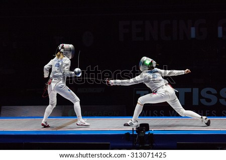 MOSCOW, RUSSIA - MAY 31 2015: Y. Egorian (R) attack E. Dyachenko (L) on final during the World  fencing Grand Prix Moscow Saber in Luzhniki sport palace - stock photo