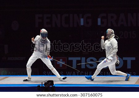 MOSCOW, RUSSIA - MAY 31 2015: Yana Egorian and Mariel Zagunis rejoice on the World  fencing Grand Prix Moscow Saber in Luzhniki sport palace - stock photo