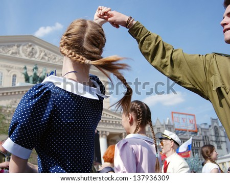 MOSCOW, RUSSIA - MAY 09: Young actors dressed as army soldiers performing on the Theater Square, by the Bolshoi Theater. Victory Day celebration on May 09, 2013 in Moscow.
