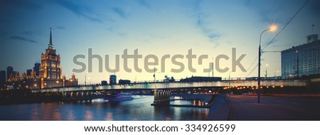 Moscow, Russia, night landscape with Novoarbatsky bridge over the river. instagram image filter retro style - stock photo