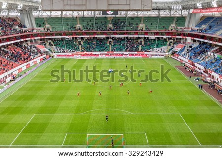 MOSCOW, RUSSIA - NOV 02, 2014: Grandstands and play-field at stadium Locomotive during game. - stock photo