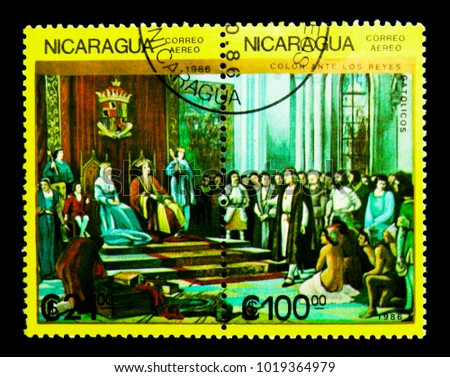 MOSCOW, RUSSIA - NOVEMBER 25, 2017: A stamp printed in Nicaragua shows Ferdinand, Isabella, Columbus with crew before throne, serie, circa 1986