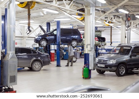 MOSCOW. RUSSIA - NOVEMBER 17, 2014: Cars for repair service station. Auto Service is the official dealer of Auto VAZ - stock photo