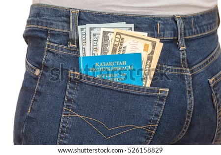 MOSCOW, RUSSIA - NOVEMBER 27, 2016: Kazakhstan passport and dollar bills in the back jeans pocket. Money for travel and shopping