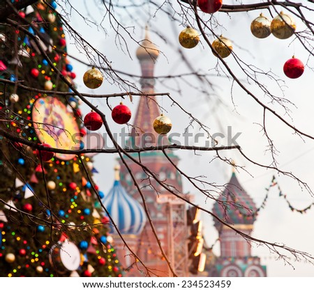 MOSCOW, RUSSIA - NOVEMBER 30, 2014: Moscow decorated for New Year and Christmas holidays. Christmas balls on tree branches near to St. Basil's Cathedral on Red square - stock photo