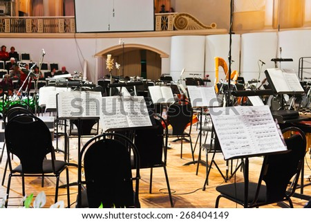 MOSCOW, RUSSIA - NOVEMBER 15: Musical instruments and sheet music at Chaikovsky Hall on November 15, 2011 in Moscow, Russia. - stock photo