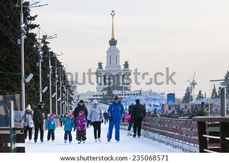 MOSCOW, RUSSIA - NOVEMBER 29, 2014: People at Skating rink on VDNKh (All-Russia Exhibition Centre), Moscow, Russia. It  is the largest ice rink in the world - stock photo