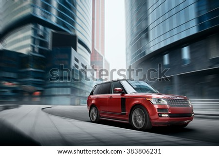 Moscow, Russia - November 22, 2015: Premium car Land Rover Range Rover fast drive on road in the city at daytime - stock photo
