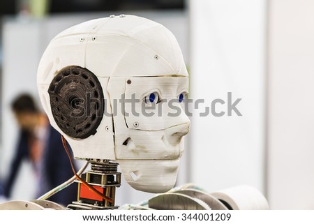"Moscow, Russia, November 20, 2015: 3rd International Exhibition of Robotics and advanced technologies ""Robotics Expo"" in Moscow. robot head shot close-up. Focus on the robot's head. plastic robot"